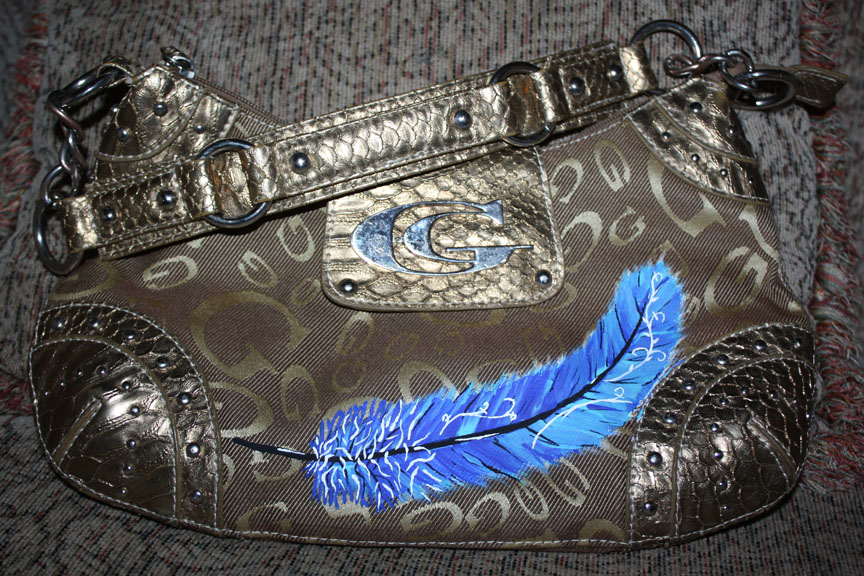 Funky Feather gold studded purse
